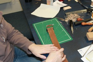 The Buckle has been sewn onto the belt.